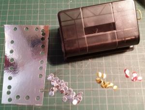 Make Metallic dots using a Hole Punch.